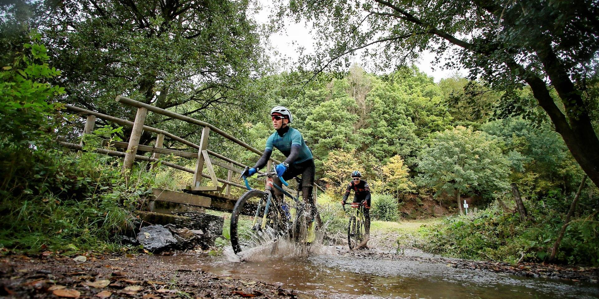 Two gravel grinders crossing a river